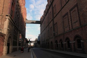The Guinness Storehouse (on the left), which was constructed in 1902 AD as a fermentation plant for the St. James's Gate Brewery, but now serves as a tourist attraction.