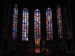 The stained glass windows behind the altar inside Notre-Dame Cathedral.
