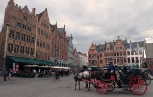 "Horse carriages in the Market Square (the ""Markt""), the central plaza next to the Belfry of Bruges."