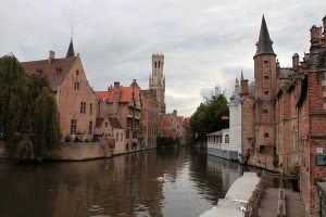 Canal with the Belfry of  Bruges in the background.
