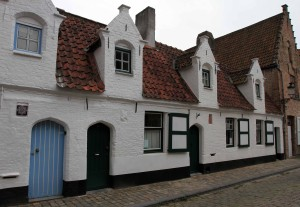 An old, white building in Bruges.