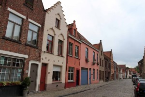 Another street lined with historic buildings in Bruges.