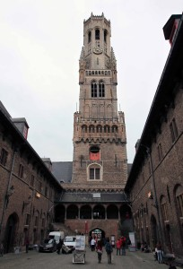 Looking at the Belfry of Bruges from inside the former Market Hall.