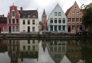 Houses and their reflections along the canal.