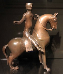 A bronze candlestick in the shape of a knight on horseback (1200-1225 AD).