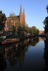 De Krijtberg Kerk and Singel canal in the morning light.