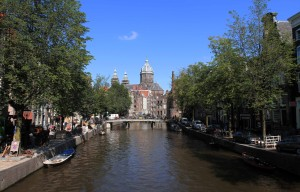 The Basilica of St. Nicholas with the Oudezijds Voorburgwal canal in the foreground.