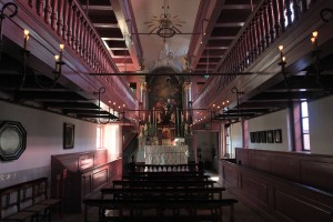 Inside Our Lord in the Attic Church, a clandestine Catholic Church that was built on the third floor inside a canal house in the 1660s, a time when Catholics and other dissenters of the Dutch Reformed Church were persecuted.