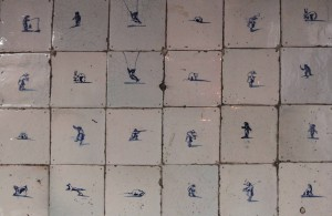 Various figures painted on the tiles inside the kitchen in the canal house.
