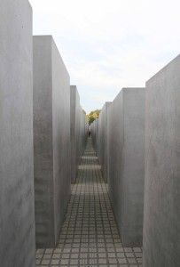 "Walking through the Memorial to the Murdered Jews of Europe, which was built in 2004 AD and consists of 2,711 concrete slabs or ""stelae."""