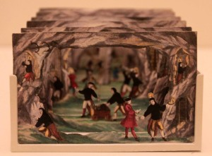 A paper theater depicting the activity in a mine (1730 AD).