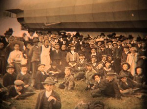 Image of crowds gathered outside a landed Zeppelin - made for a stereoscope.