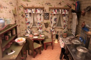 The interior of a doll's house that was made in 1933 AD and is decorated with National Socialist leaders and wallpaper depicting Hitler Youth scenes - designed to indoctrinate Germany's youth.