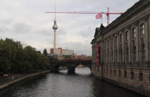 "The Spree River with the Fernsehturm (""Berlin TV Tower"") in the background."