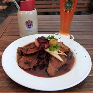 A wheat beer and a Franconian marinated pot roast with apple slices and a wine braised red cabbage.