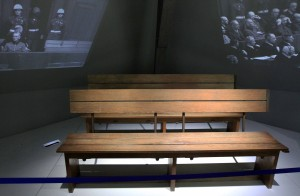 Benches used by the defendants (in front: Hermann Göring, Rudolf Hess, Joachim von Ribbentrop, and Wilhelm Keitel; behind: Karl Dönitz, Erich Raeder, Baldur von Schirach, and Alfred Jodl) during the Nuremberg trials.