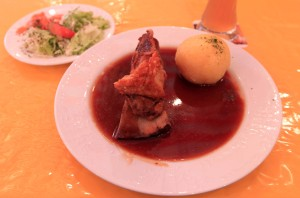 My meal at the Nuremberg Old Town Festival: a pork shoulder roast and dumpling served in a pool of gravy, a mixed salad, and beer.
