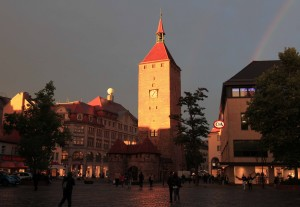 The White Tower at sunset with a rainbow in the sky, seen from Jakobsplatz.