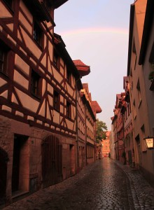A narrow street in Nuremberg basking in the sun's waning rays.