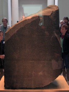 The Rosetta Stone, which is inscribed with a decree (on behalf of King Ptolemy V) in three different scripts: Ancient Egyptian hieroglyphs, Ancient Egyptian Demotic script, and Ancient Greek (196 BC).