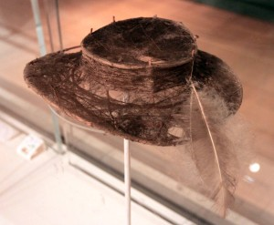A hat made from spider's web, cane, and ostrich feathers; it was created by the San people in southern Africa (early-20th-century AD).