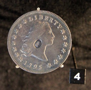 A counter-marked American Liberty dollar; made during the Crisis of 1797 - it was quicker to stamp King George III's portrait on to foreign coins than to melt them down and make new ones.