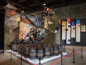 A dragon made of weapons and armor and displayed inside the White Tower.