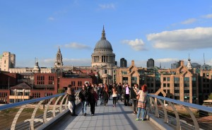 Walking on the Millennium Bridge (opened in 2000 AD) with St. Paul's Cathedral in view.