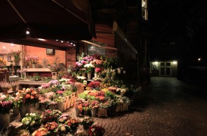 A flower shop at night.