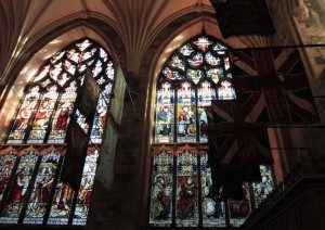 Stained glass windows and retired regimental colors inside St. Giles' Cathedral.