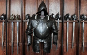 Suit of armor, pikes, and swords on display inside the Great Hall.