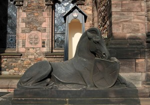 Statue of a horse and shield outside the entrance to the Scottish National War Memorial.