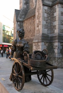 "Statue of Molly Malone (designed by Jeanne Rynhart and unveiled in 1988 AD for Dublin's millennium-old celebration). ""In Dublin's fair city, Where the girls are so pretty, I first set my eyes on sweet Molly Malone, . . ."""