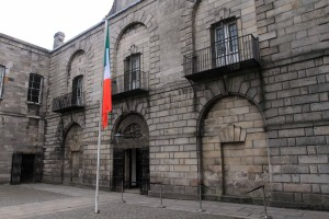 "The entrance to Kilmainham Gaol. The gaol (""jail"") was originally built in 1796 AD and is where leaders of the 1916 Easter Rising were imprisoned and executed."