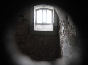 Peering in to a prison cell.