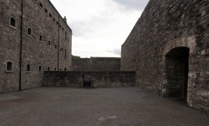In the prison yard with the West Wing of the gaol on the left.