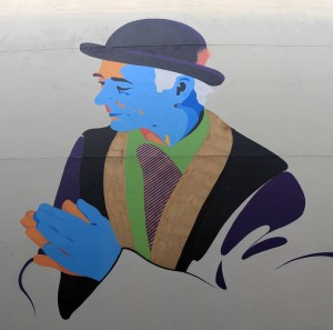 Portrait of B.P. Fallon (an Irish DJ, author, photographer, and musician) on the side of a building, by the artist Maser.
