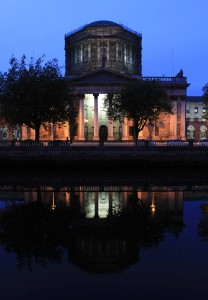 The Four Courts building at night.