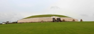 Newgrange passage tomb mound, which was originally built sometime between 3000 and 2500 BC; it was subsequently sealed, buried, and forested before being discovered again (in the 17th-century AD) and rebuilt (in the 1970s).