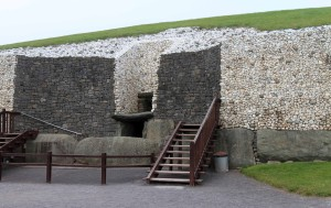 The entrance to the passage tomb at Newgrange with its entrance stone covered in megalithic art.