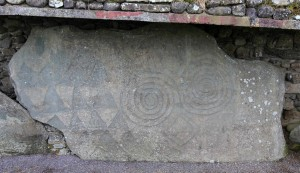 Another stone, along the outer edge of the mound, covered with megalithic art.