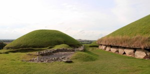The ruins of a satellite tomb and another reconstructed satellite tomb, with the outer edge of the larger passage tomb on the right.