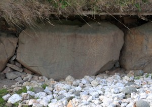 Megalithic art on one of the stones bordering the large passage tomb at Knowth.