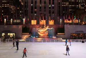 Another view of the ice-skating rink in front of Rockefeller Center with the statue of Prometheus in the center.