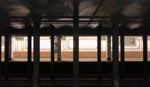 The platform and tracks inside the Cathedral Parkway – 110th Street Subway Station.