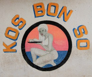 Painted sign for the Kos Bon So restaurant in Rincon Village.