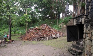 The mound of coconut husks and the furnace they will fuel.