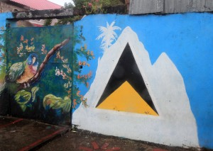 A parrot and the flag of Saint Lucia painted on a wall along the road.