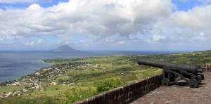 A canon facing out to sea with Sint Eustatius (a Dutch island) in view.