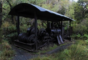 "An abandoned log hauler (also known as a ""steam winch"") along the trail; these stationary machines would pull logs attached to ropes or cables for timber milling."